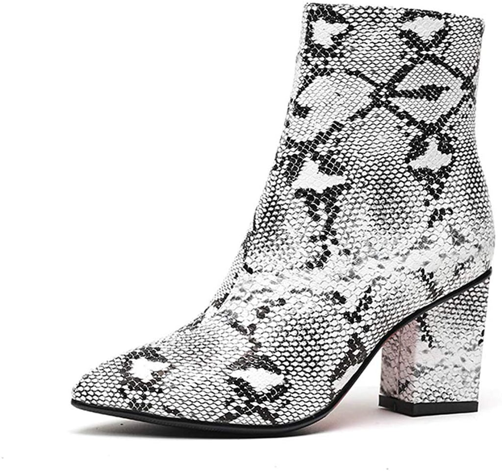 This image has an empty alt attribute; its file name is 15.Wetkiss-Snake-Ankle-Boots.jpg